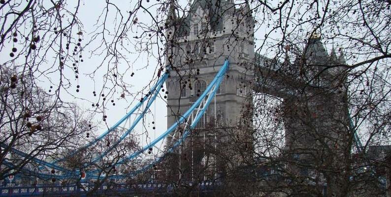 Tower Bridge under gloomy skies.