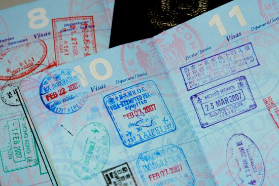 Image of Passport stamps/Credit: J Aaron Farr, Flickr, CC 2.0