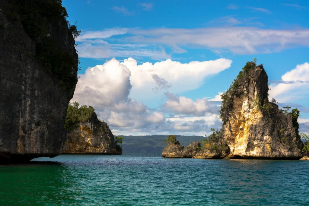 Rock formation in sea, Kabui Bay, Raja Ampat / Roy Singh / 500px via Lonely Planet