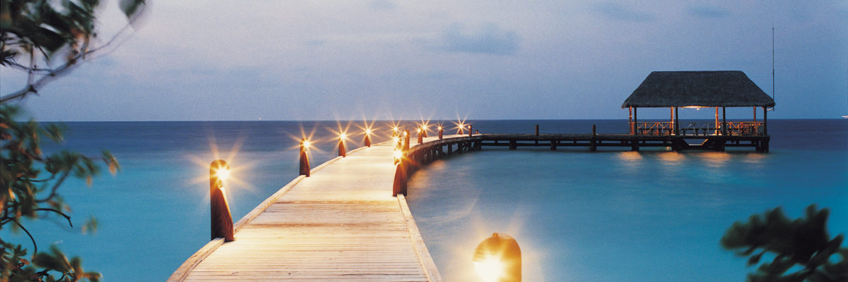 Arrival jetty at night, COMO Cocoa Island, Makunufushi, South Male Atoll, Maldives / COMO Hotels and Resorts