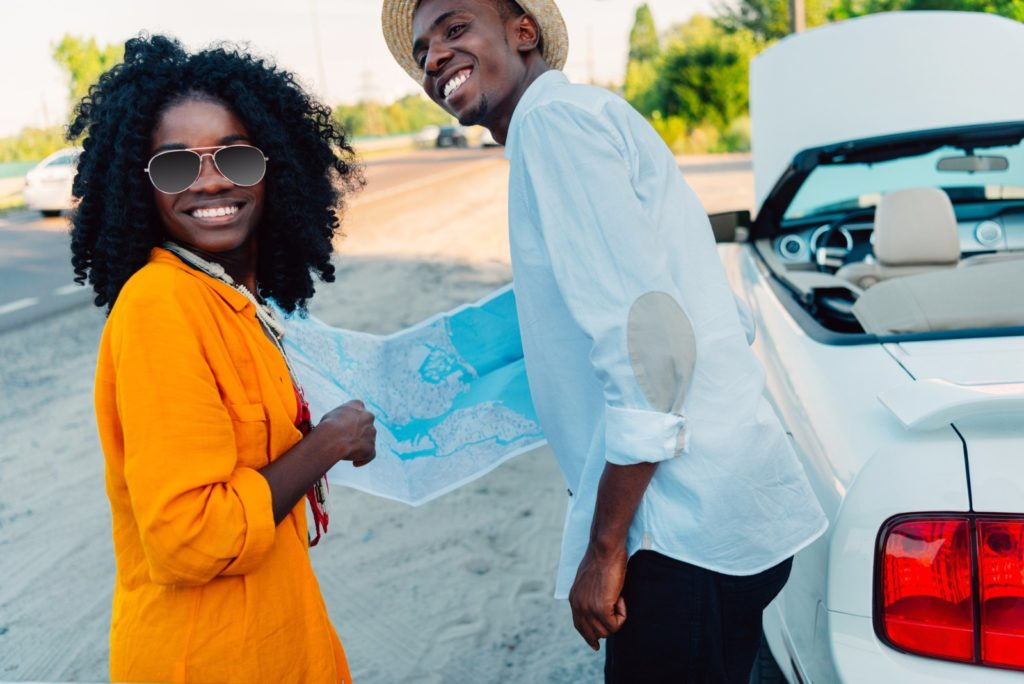 African american couple with map / Copyright: ArturVerkhovetskiy